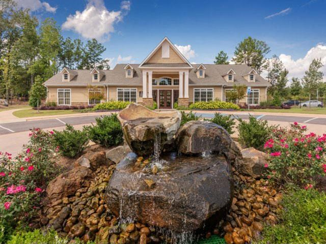 Lush landscaping surrounds you as you drive into Ashby at Ross Bridge, Hoover, AL 35226