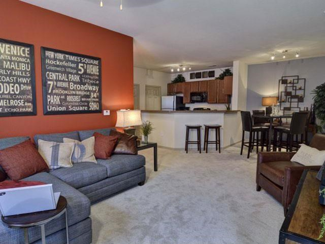 Gorgeous Modern Living Room with Two Tone Paint Colors and Wood Plank Vinyl Flooring (in Select Units) at Ashby at Ross Bridge, Hoover, AL 35226