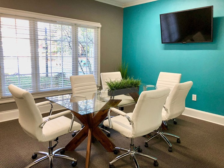 Business Center With Conference Room Table plus chairs with seating for 6 at Autumn Park Apartments, Charlotte, NC 28262