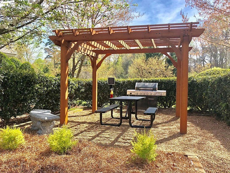 Trellised Outdoor Social & Picnic Areas surrounded by lush landscaping at Autumn Park Apartments, Charlotte, NC 28262