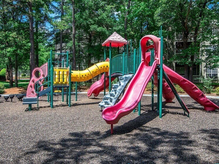 Children have a place to run and play at Autumn Park too! Slides, Climbing Equipment and Racetrack at Autumn Park Apartments, Charlotte, NC 28262