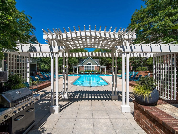 Two Sparkling Swimming Pools with Expansive Sundecks, Lounge Chairs, Umbrellas and Relaxing Courtyard at Autumn Park Apartments, Charlotte, NC 28262