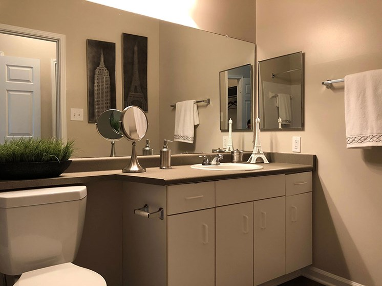 Relax after a long day in your bathroom with garden tub, unique cabinets, LED lighting at Autumn Park Apartments, Charlotte, NC 28262