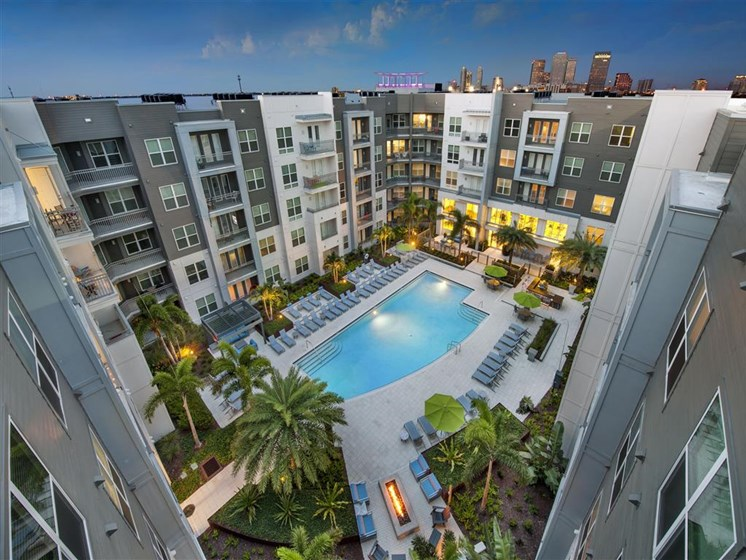Pool with Lounge Chairs and Palm Trees at Bleecker Hyde Park, Tampa, FL, 33606