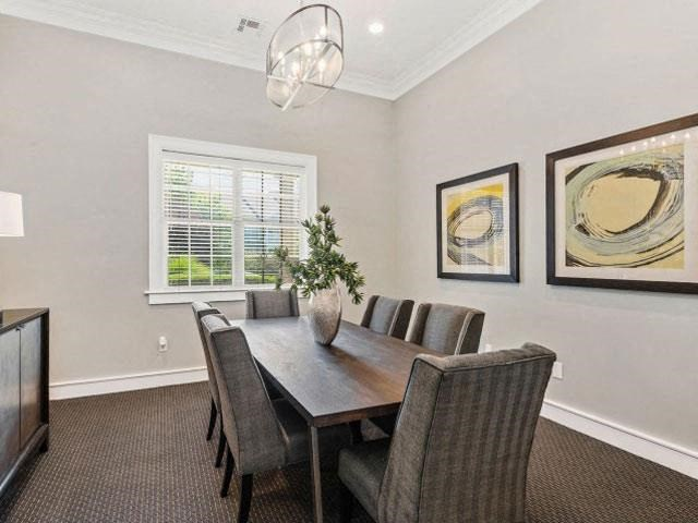 Conference Space with Elegant Lighting and Wood Plank Vinyl Flooring at Cambridge Square Apartments, Overland Park, KS 66211