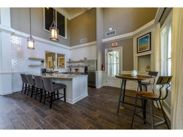 Stunning Modern Design Community Clubhouse with Ample Space and Amenities like Coffee Bar and Fireplace Lounge at Legacy Farm Apartments, Collierville, TN 38017