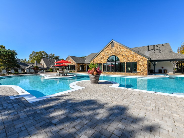 Revitalizing Resort Style Swimming Pool with Relaxation Space and Seating Area at Pointe Royal Townhome Apartments, Overland Park, KS 66213