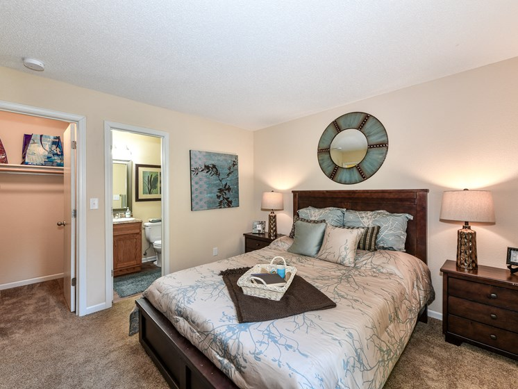 Master Bedroom Feels Large and Spacious with Impressive 9 Foot Ceilings and Large Walk-In Closets at Pointe Royal Townhome Apartments, Overland Park, KS 66213