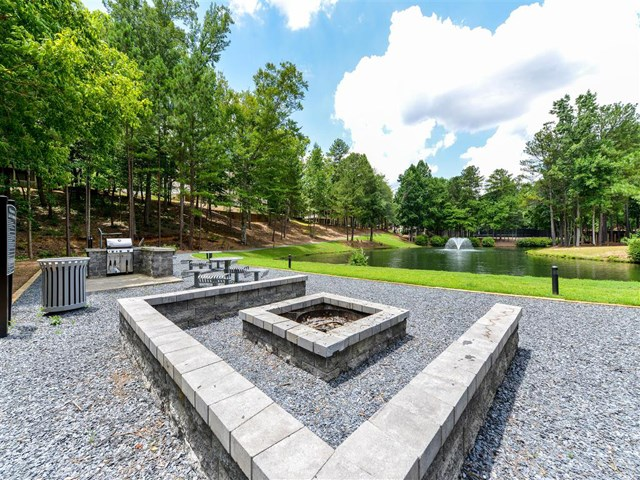 Gathering Area With Grills And Corn Hole at St. Andrews Apartment Homes, Johns Creek