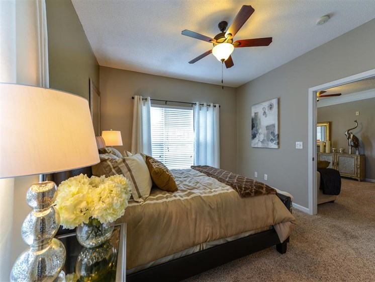 Master Bedroom Feels Large and Spacious with Impressive 9 Foot Ceilings and Large Walk-In Closets at Sugarloaf Crossing Apartments, Lawrenceville, GA 30046