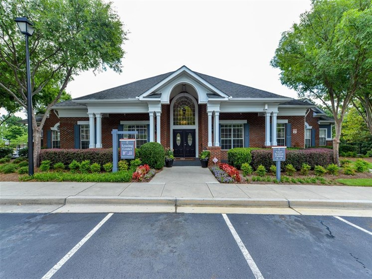 Lush landscaping surrounds you as you drive into Sugarloaf Crossing Apartments, Lawrenceville, GA 30046