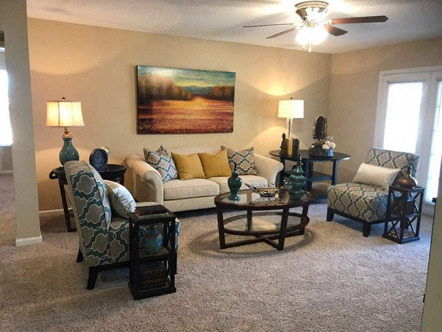 Gorgeous Modern Living Room with Plenty of Room for Furniture. New Carpet, Large Window Doors and Fresh Paint at The Addison at Collierville Apartments, Collierville, TN 38017