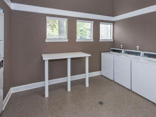 Laundry Convenience with Two Clothes Care Centers at The Summit Apartments, Memphis, TN 38128