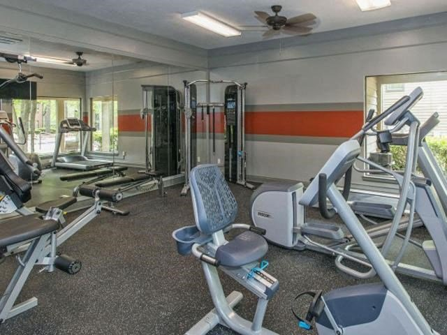 Upgraded Health and Fitness Club including TVs and Cardio and Weight Training at The Summit Apartments, Memphis, TN 38128