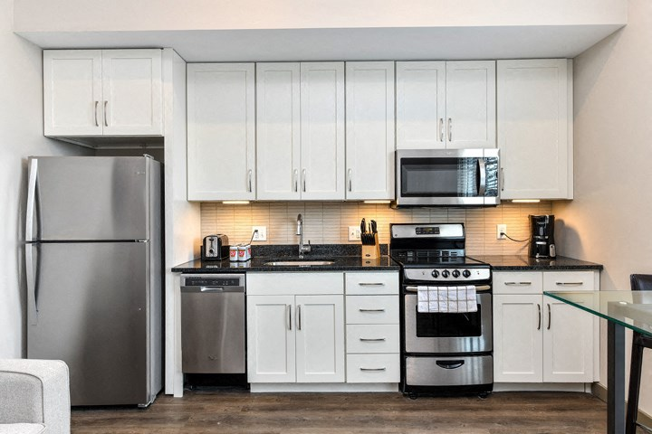 Gourmet Kitchens with Stainless Steel Appliances and White Shaker Style Cabinetry and Brushed Nickel Hardware at Legends at The Tennessee Brewery, Memphis, TN 38103