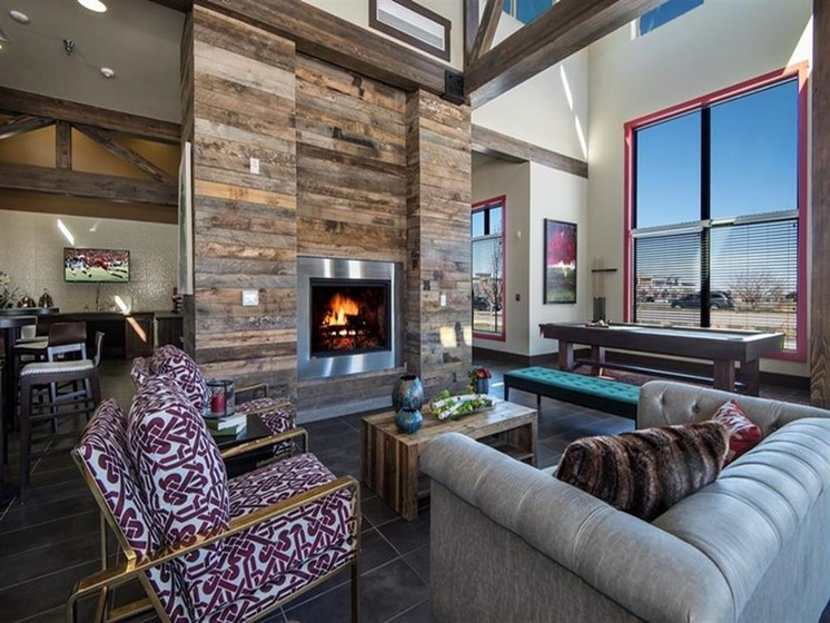 clubroom with pool table and fireplace