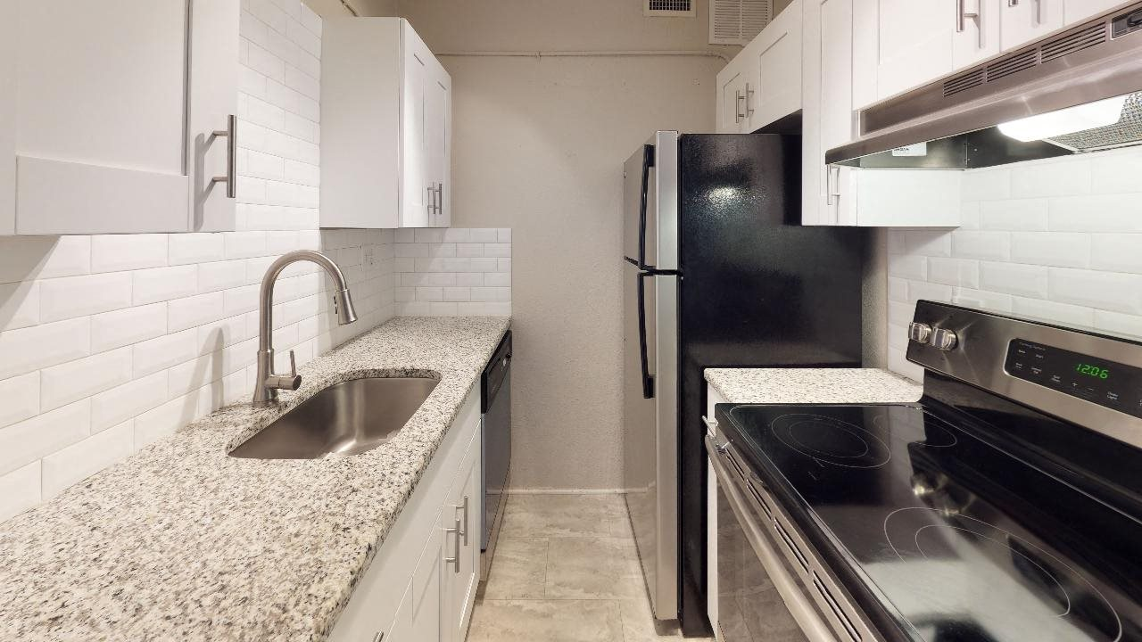 Newly renovated kitchen with granite countertops and stainless steel appliances
