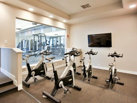 The Highland Apartments Fitness Studio with spin bikes and fitness on demand tv