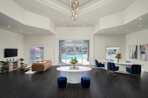 The Highland apartments leasing office with dark faux wood floors, white walls and views of the pool