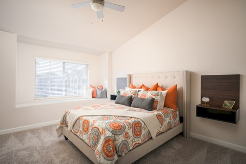 Model Master Bedroom with wall to wall carpet, ceiling fans and large window seat