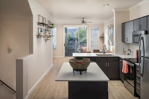 Model kitchen with island and white quartz cabinets