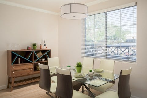 model dining room with table for 6 and large sideboard table, large windows and lighting