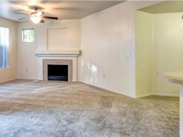 Ingleside Apartments Living Room with wall to wall carpet and fireplace