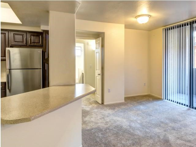 Ingleside Apartments kitchen and living room with sliding glass door to outside