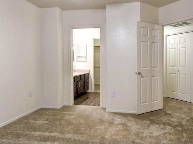 Ingleside Apartments Bedroom with wall to wall carpet and attached bathroom