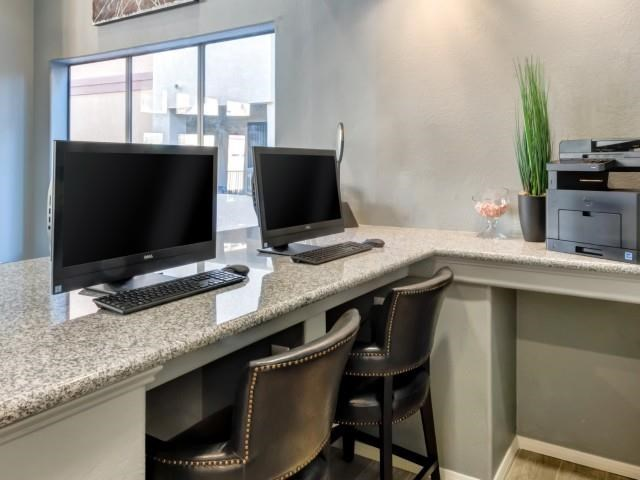 Ingleside Apartments Business Center with two computer screens and grey granite countertops and printer