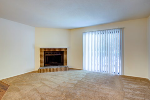 living room view with fireplace and balcony