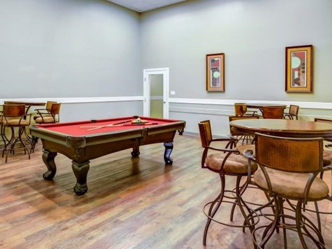 Game room with pool table and high-top table seating