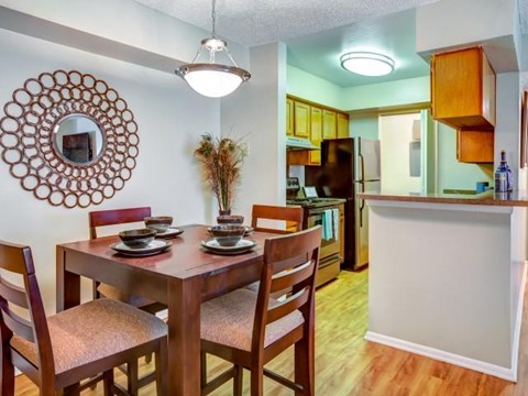 Dinning room opening into kitchen with modern lighting