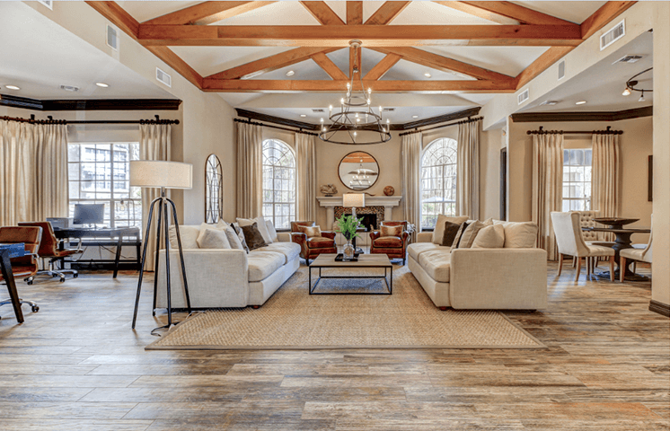 Resident Clubhouse entrance with lounge seating, fireplace, and business center