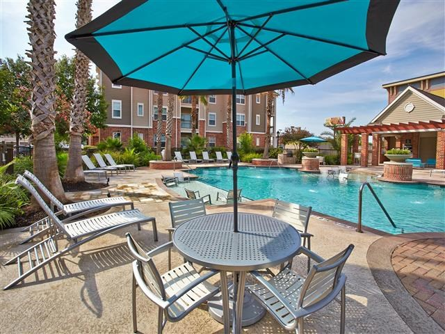 Umbrella covered table and seating with pool view
