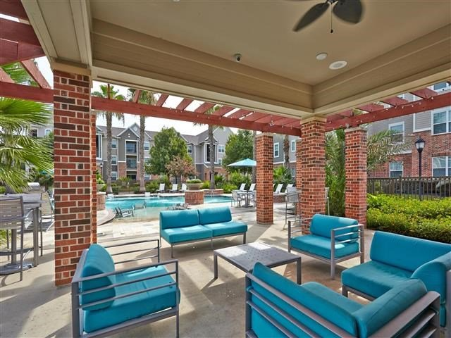 Covered poolside seating with ceiling fan