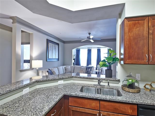 Kitchen granite countertop and bar over looking living room