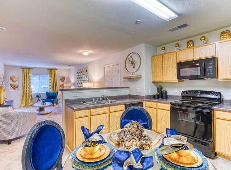 Kitchen interior with blue accessories  at Alaris Village Apartments, Winston-Salem, NC