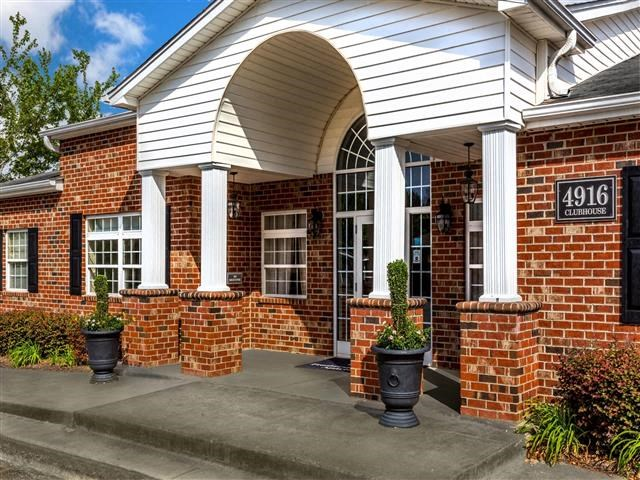 Front Office Entrance With Beautiful Brick Construction at Featherstone Village Apartments, Durham, NC