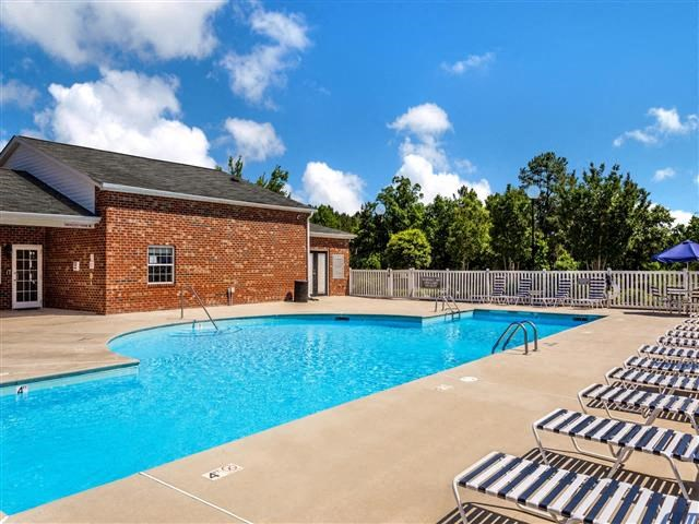 Swimming Pool with Lounge Chairs at Featherstone Village Apartments, North Carolina, 27703