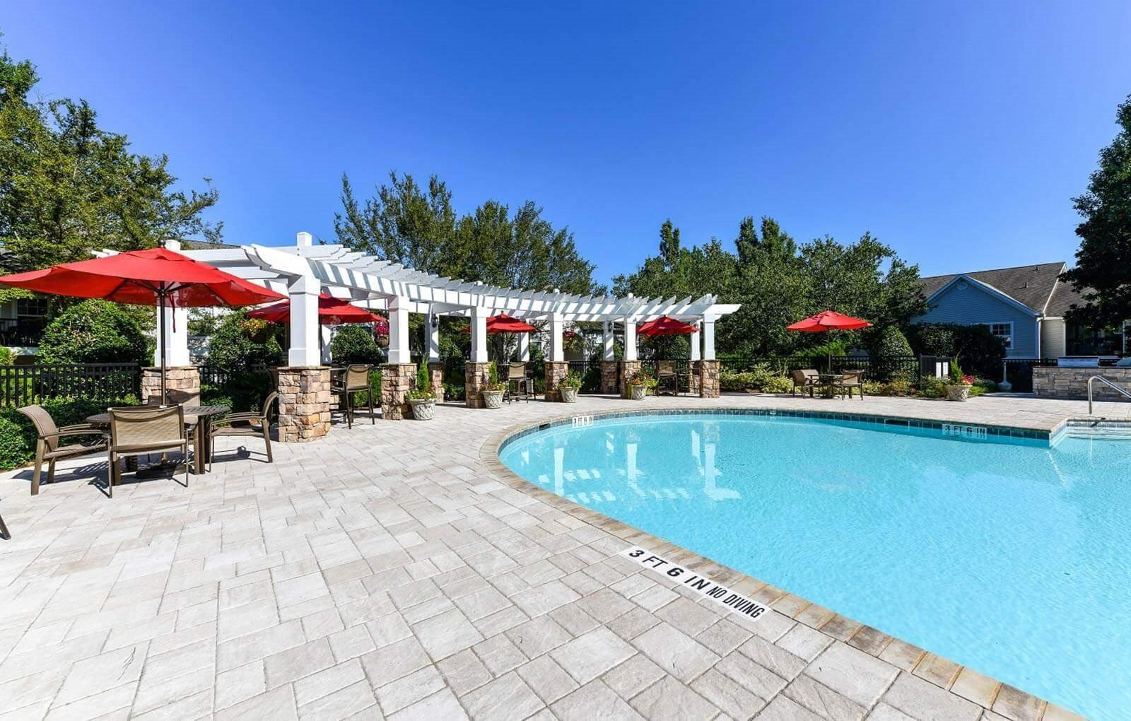 Refreshing Swimming Pool with Relaxing Poolside Cabanas at Lake Cameron Apartment Homes, Apex, NC 27523