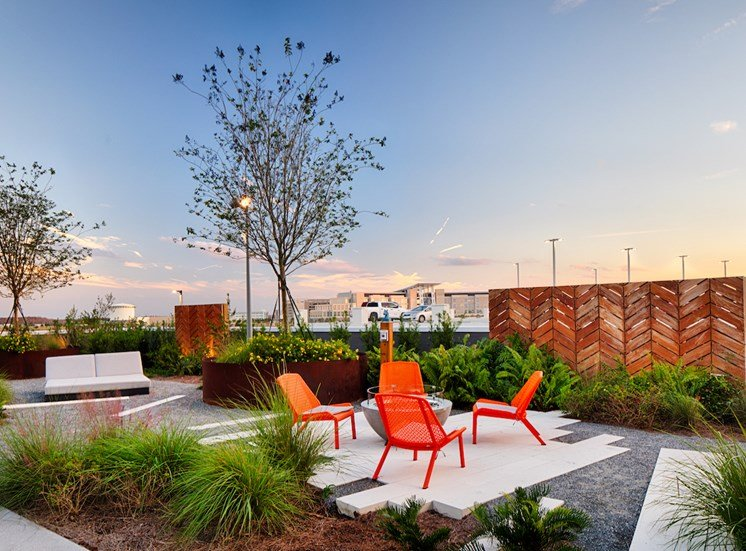 Chairs surrounding fire pit on amenity deck at Pixon