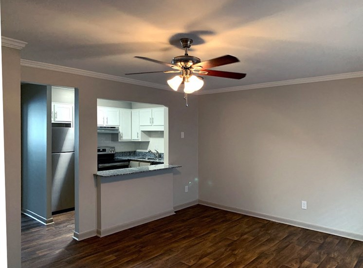 upgraded apartment with hardwood-style flooring and modern ceiling fan