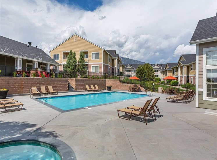 Relaxing Pool Area With Sundeck at Village at Westmeadow Apartments, Colorado Springs, Colorado
