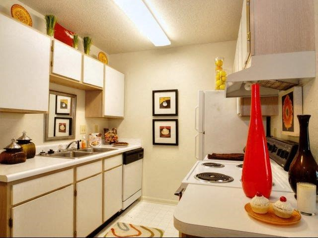 Spacious Kitchen with Pantry Cabinet at Treybrooke Village Apartments, Greensboro