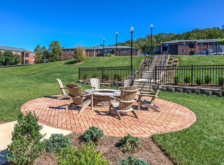 outdoor seating area next to fire pit at Ascot Point Village Apartments, North Carolina, 28803