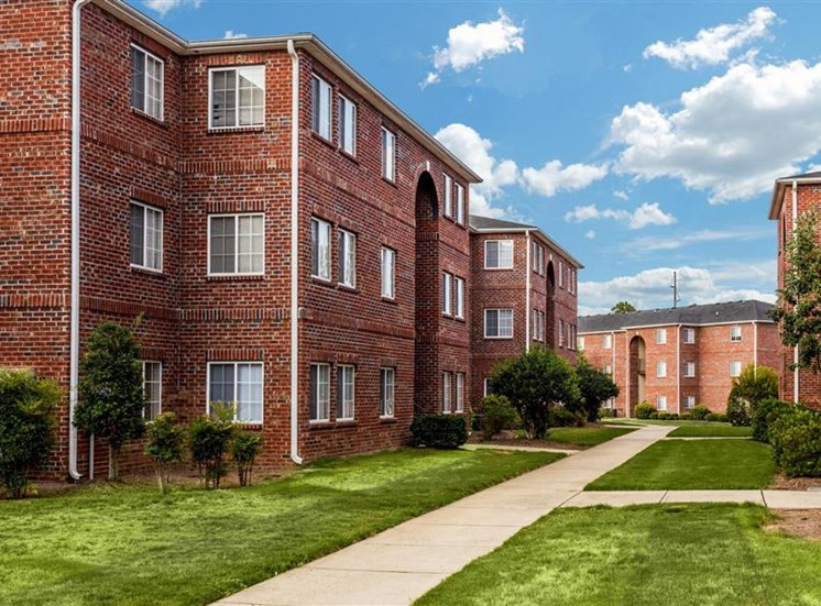 Beautiful Walking Path Between Brick Apartment Buildings at Eagle Point Village Apartments, Fayetteville, NC, 28314