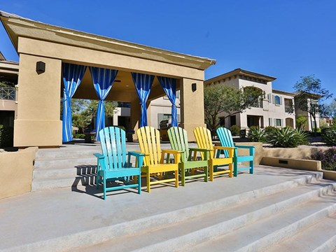 Covered community barbecue area with outdoor chairs