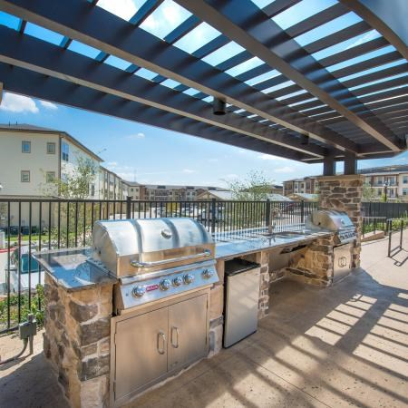 Grilling station for residents under a pergola