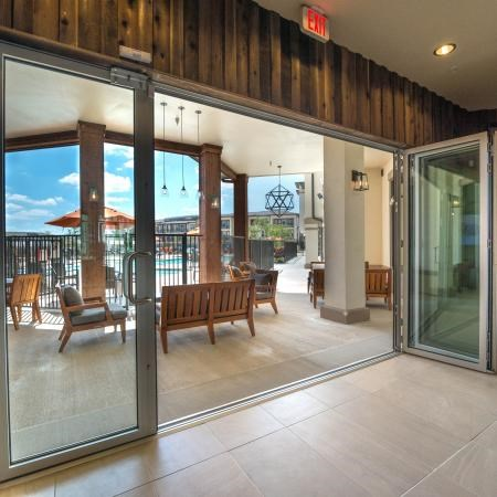 Clubhouse patio and outdoor seating with a gorgeous pool view